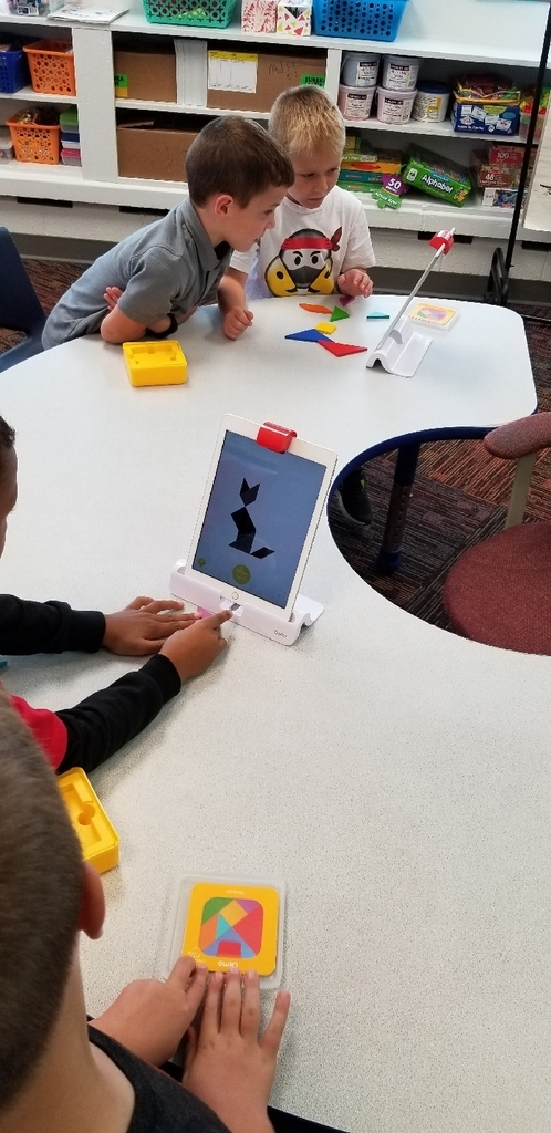 1st grade working with shapes on the Osmo.