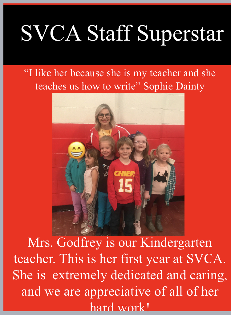Mrs. Godfrey with some of her Kindergarteners.